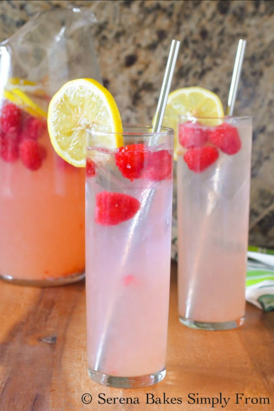 Sparkling Raspberry Lemonade is a light refreshing easy to make drink with a cocktail option by the addition of your favorite liquor from Serena Bakes Simply From Scratch.