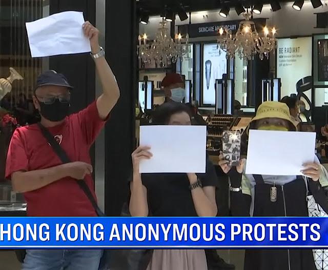 Proibido falar, hong konguesees protestam com folhas em branco.