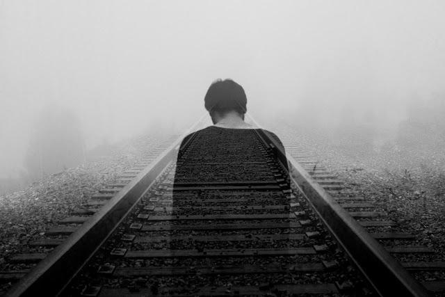 man head down railway tracks - unsplash.com