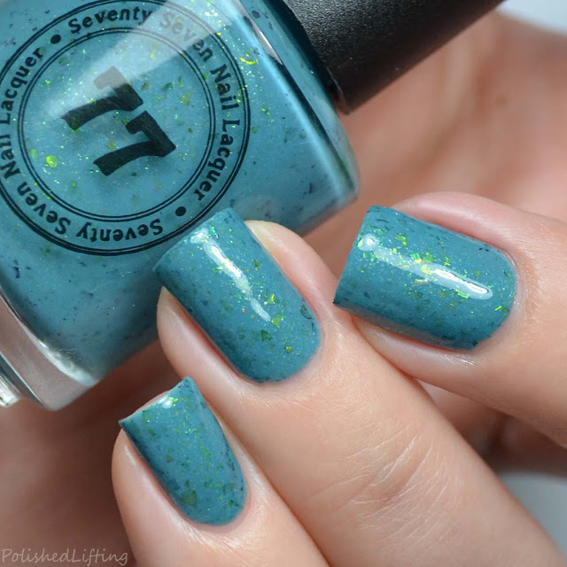teal nail polish with green flakies
