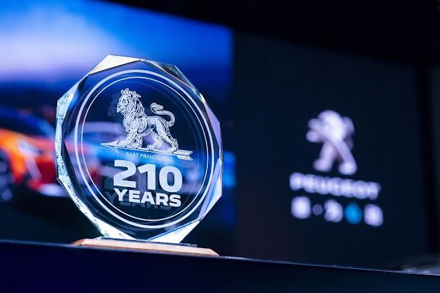logo peugeot 210 tahun
