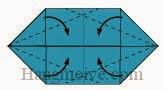 Bước 7: Gấp chéo bốn góc tờ giấy vào trong.