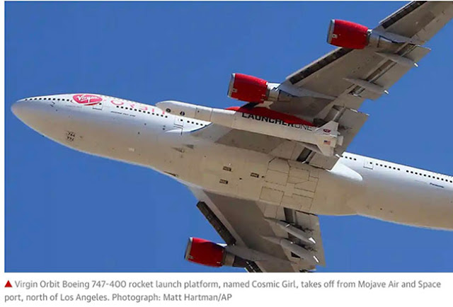 """Virgin Orbit Boeing 747 """"Cosmic Girl"""", with """"Launcher One"""", below wing (Source: M. Hartman/AP)"""