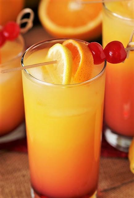 Limoncello Sunrise Cocktail Garnished with Lemon, Orange, & Maraschino Cherries Image