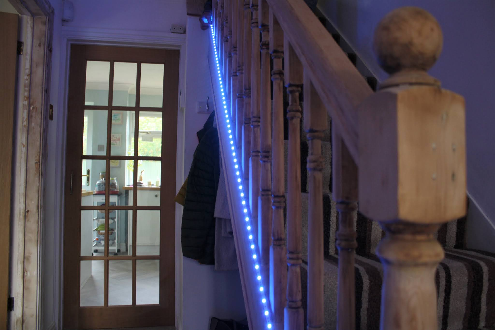 mood lighting alongside staircase, led light strip that changes colours