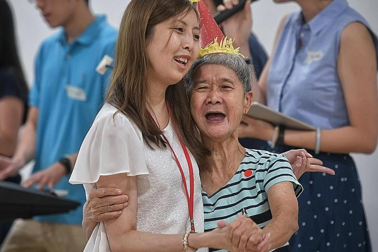 Ms Sherry Soon with a resident at the THK Home for the Disabled@Sembawang.