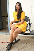 Actress Poojitha Stills in Yellow Short Dress at Darshakudu Movie Teaser Launch .COM 0248.JPG