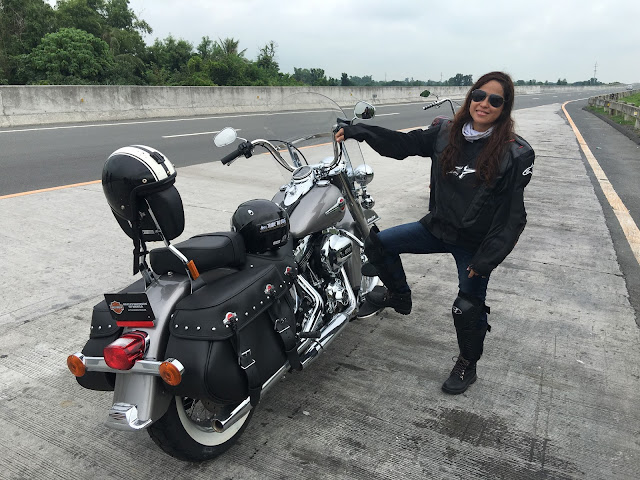 Kara Santos is shown with a big bike