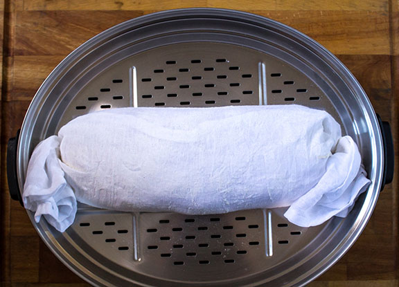 Pudding in muslin cloth ready to steam