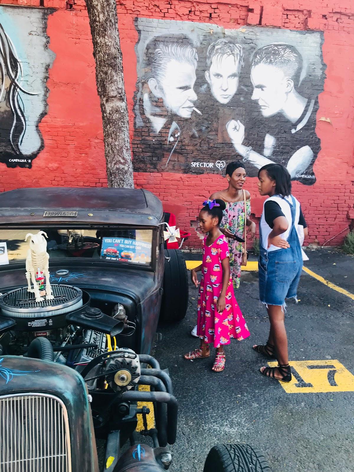 Image: Woman and Kids at Dallas Texas Car Show In Deep Ellum:The Invasion Car Show Deep Ellum Dallas Texas