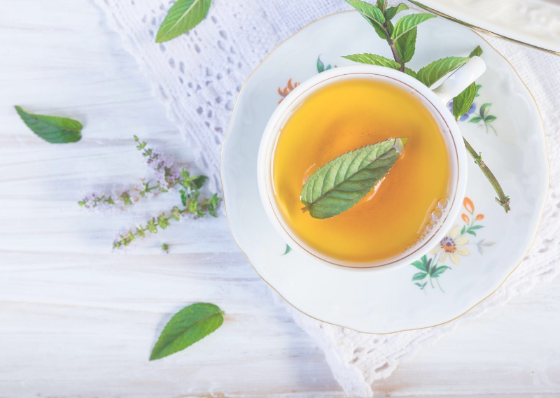 A cup of peppermint tea in a post about learning to live life with IBS.