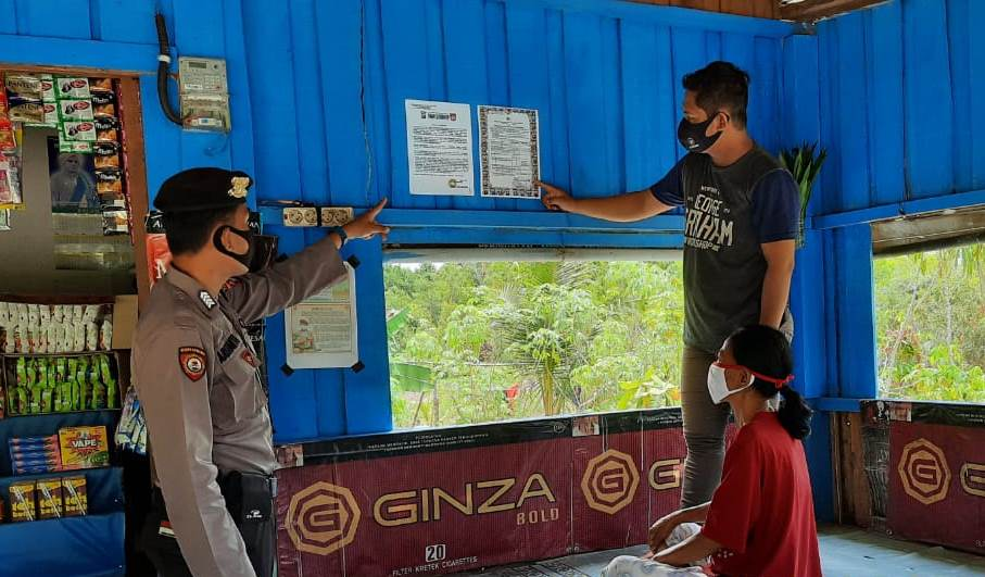 Kanit Sabhara Polsek Kahayan Tengah Lakukan Patroli Sampaikan Imbauan Cegah Covid-19