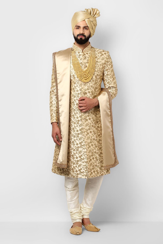e846df22a9 Groom golden colour sherwani to be an eye catcher