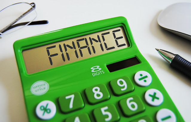 public finance written on green calculator