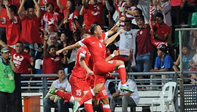 Singapore rejoices after Khairul Amri fires a goal shot