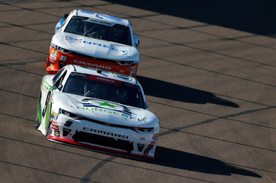 Tyler Reddick (#9 BurgerFi Chevrolet) leads Spencer Gallagher.