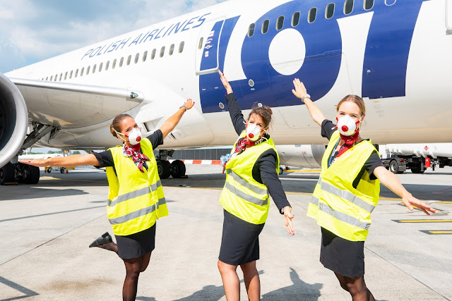 LOT Polish Airlines crew in front of jet