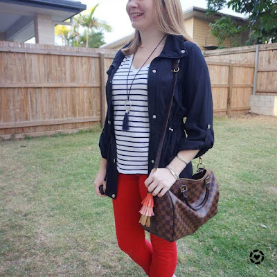 awayfromblue Instagram | school run style red skinny jeans printed tee speedy bandouliere bag