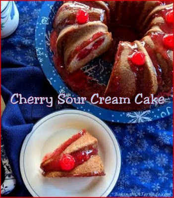 Cherry Sour Cream Cake for the holiday or any time, a beautiful dessert to share with friends and family. This homemade cake has a little tang of sour cream and is bursting with cherry flavor. | Recipe developed by www.BakingInATornado.com | #recipe #cake