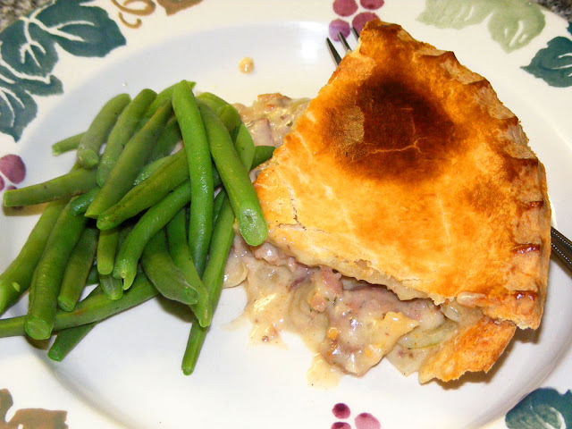 Chicken and rabbit pie with green beans. Cooked and Photographed by Susan Walter. Tour the Loire Valley with a classic car and a private guide.