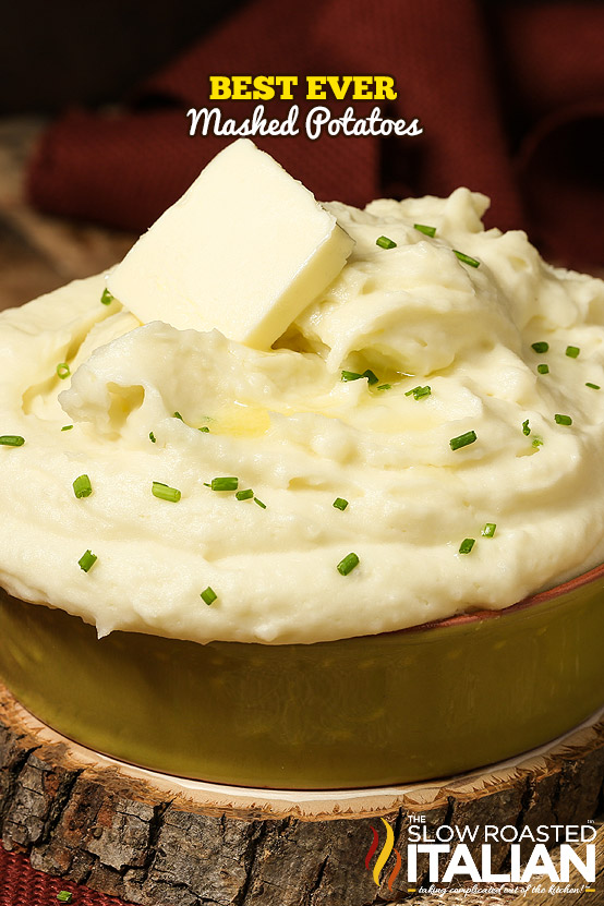 bowl of the best mashed potatoes ever, topped with chives and butter