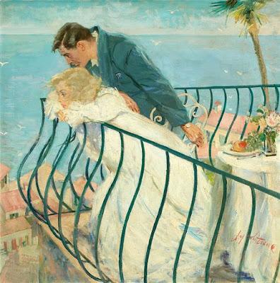 Un couple amoureux sur le balcon observant la mer.