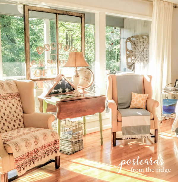 living room with salvaged doctor's office window