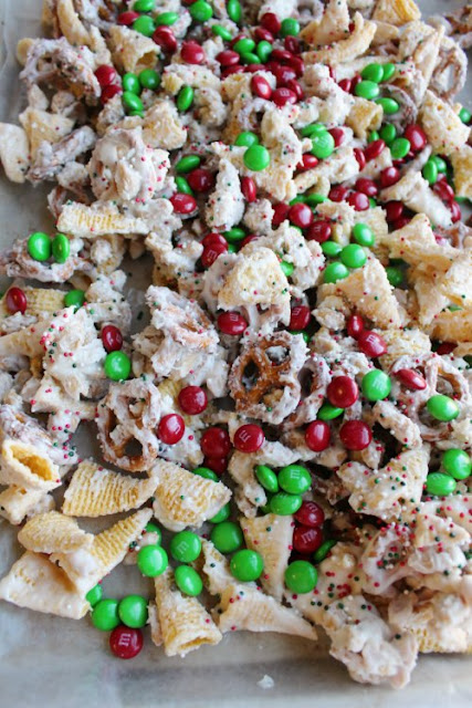 sweet and salty snack mix tossed in white chocolate with red and green candies