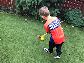 J dribbling hockey ball at home in the garden
