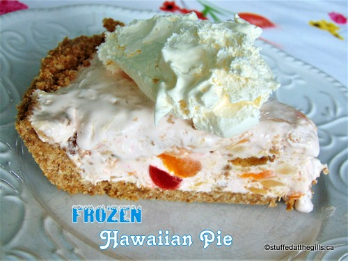 A slice of Frozen Hawaiian Pie topped with a little cream.