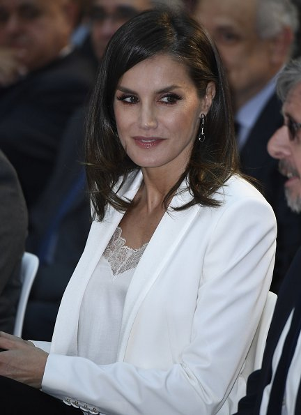 Queen Letizia wore a white blazer by Spanish fashion designer Felipe Varela, and Hugo Boss satin top, Hugo Boss black trousers