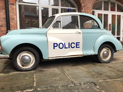 old fashioned blue police car