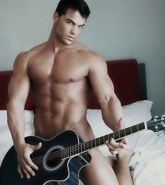 Is this guy naked with this guitar