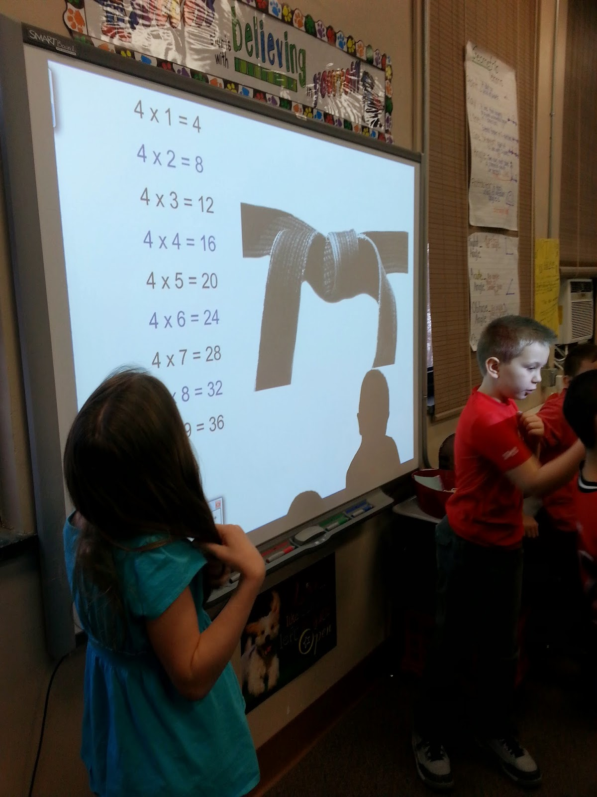 Students practicing math facts karate style