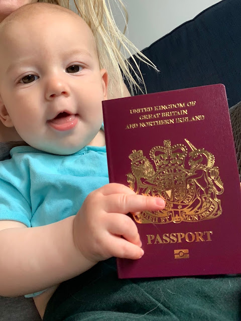 Baby Boy holding his new UK Passport (without mention of EU on it)
