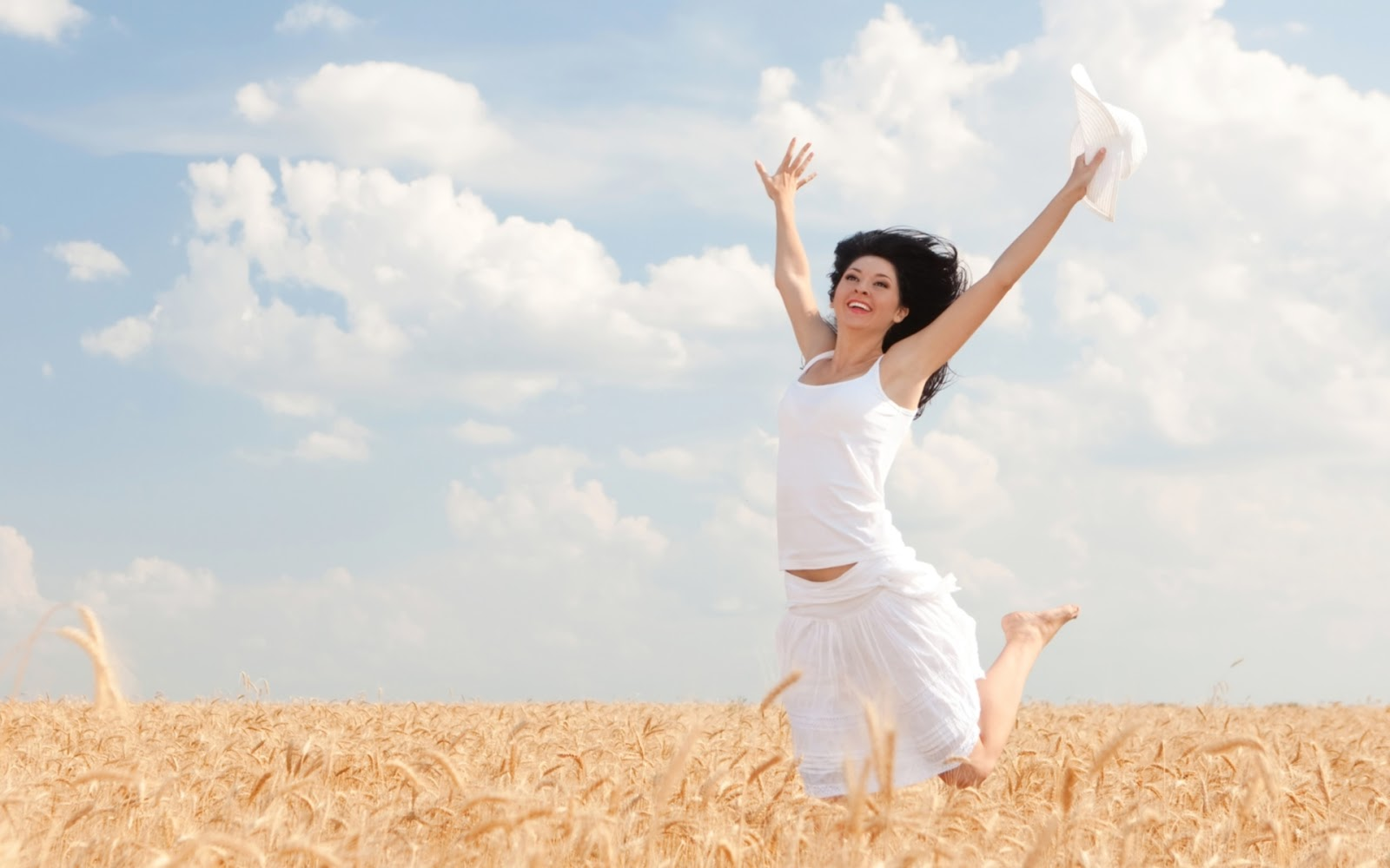 Happy Woman Jumping in Golden Wheat ~ Mystery Wallpaper