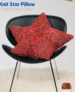 http://www.knitting-warehouse.com/free_knitting_patterns/Coats_Clark/MD_TickerTape/KnitStarPillow.pdf