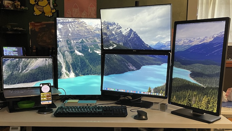Five-monitor Mac desk configuration