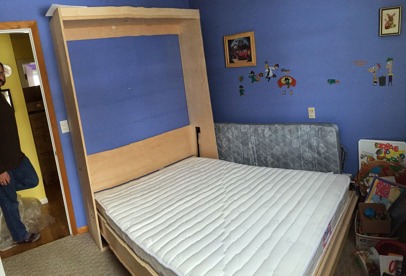 Photo of the Murphy bed open, with mattress installed.