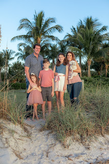 Florida family on the beach with dog