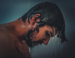 Man is taking bath.