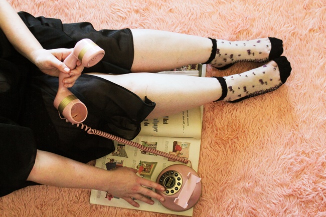 sheer embroidered socks on feet with a vintage rotary phone