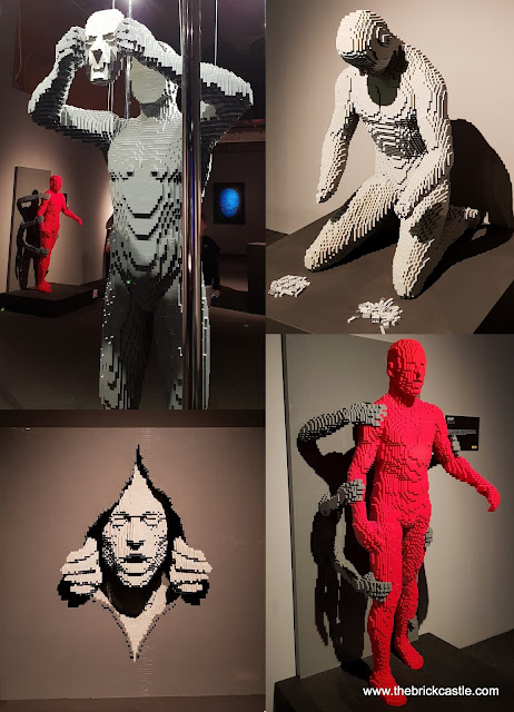 The Art Of THe Brick figures hands body being gripped human removing mask breaking through