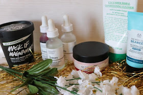 Skincare products and gold tinsel