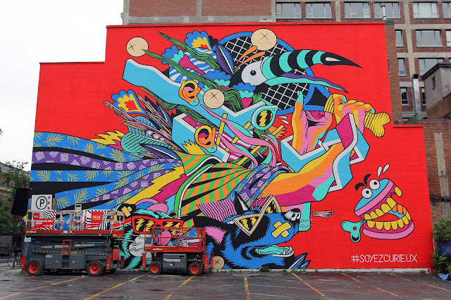 Our live coverage of Mural Festival 2015 is soon coming to an end but we still have a bunch of goodies to share with you. The Brazilian lads from Bicicleta Sem Freio just wrapped up the Mural's biggest building with this super vibrant artwork which is featuring some of their signature psychedelic imagery.