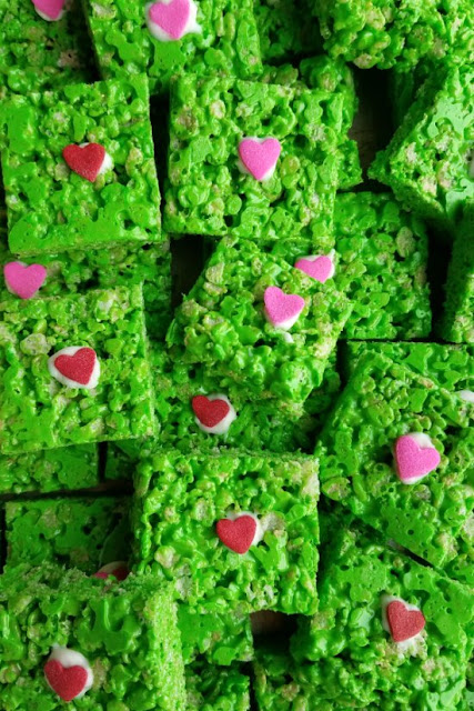 close up stack of Grinch rice krispie treats