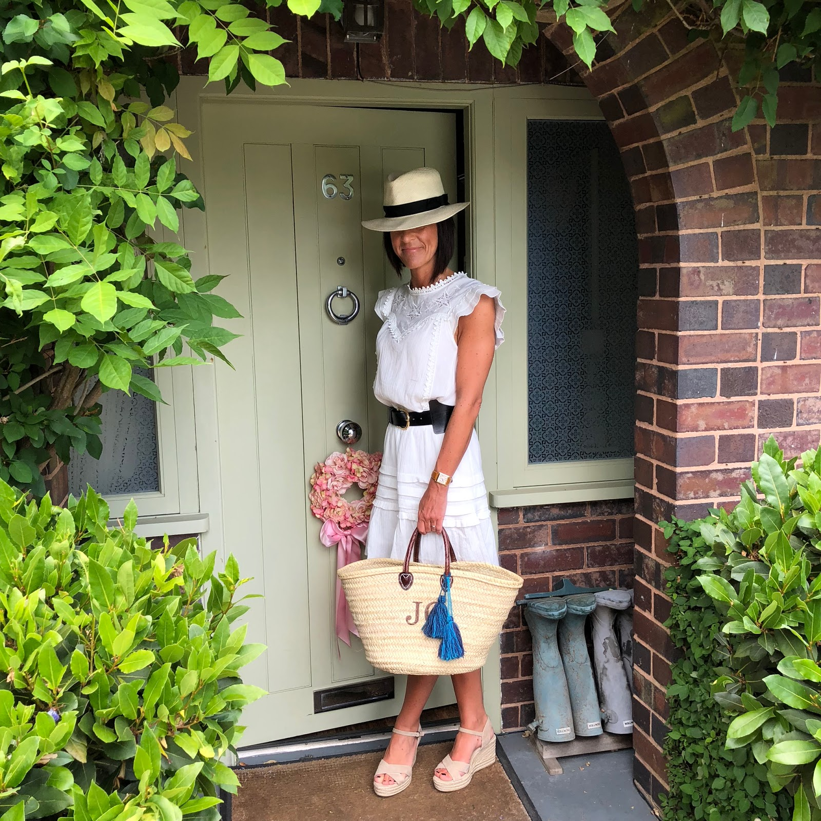 my midlife fashion chlobo solar plexus chakra necklace, hush portobello dress, initially london covent garden medium basket shopper, chlobo mini small ball double angel wing bracelet, chlobo cute charm puffed heart bracelet, and other stories waist buckle belt, marks and spencer handwoven panama hat, the white company suede espadrille sandals