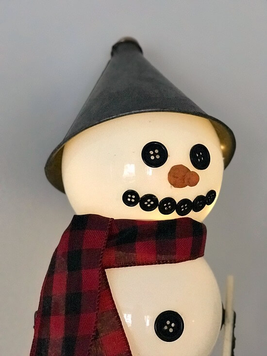 Light up snowman using repurposed and found parts