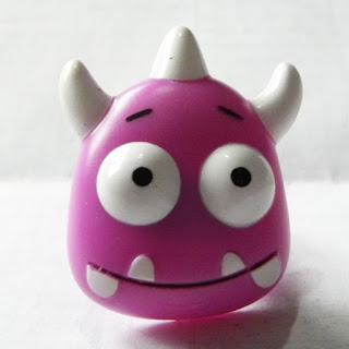 Purple plastic monster ring from Greggs