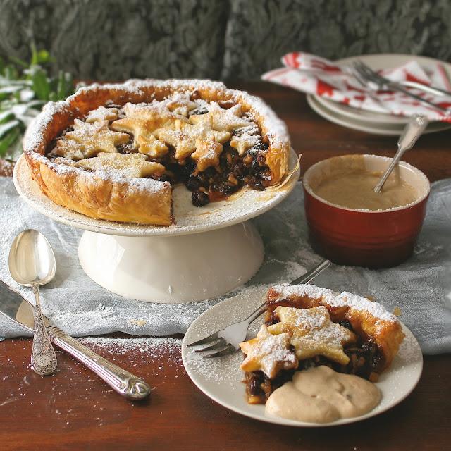 Mince pie tart slice with stars and custard.